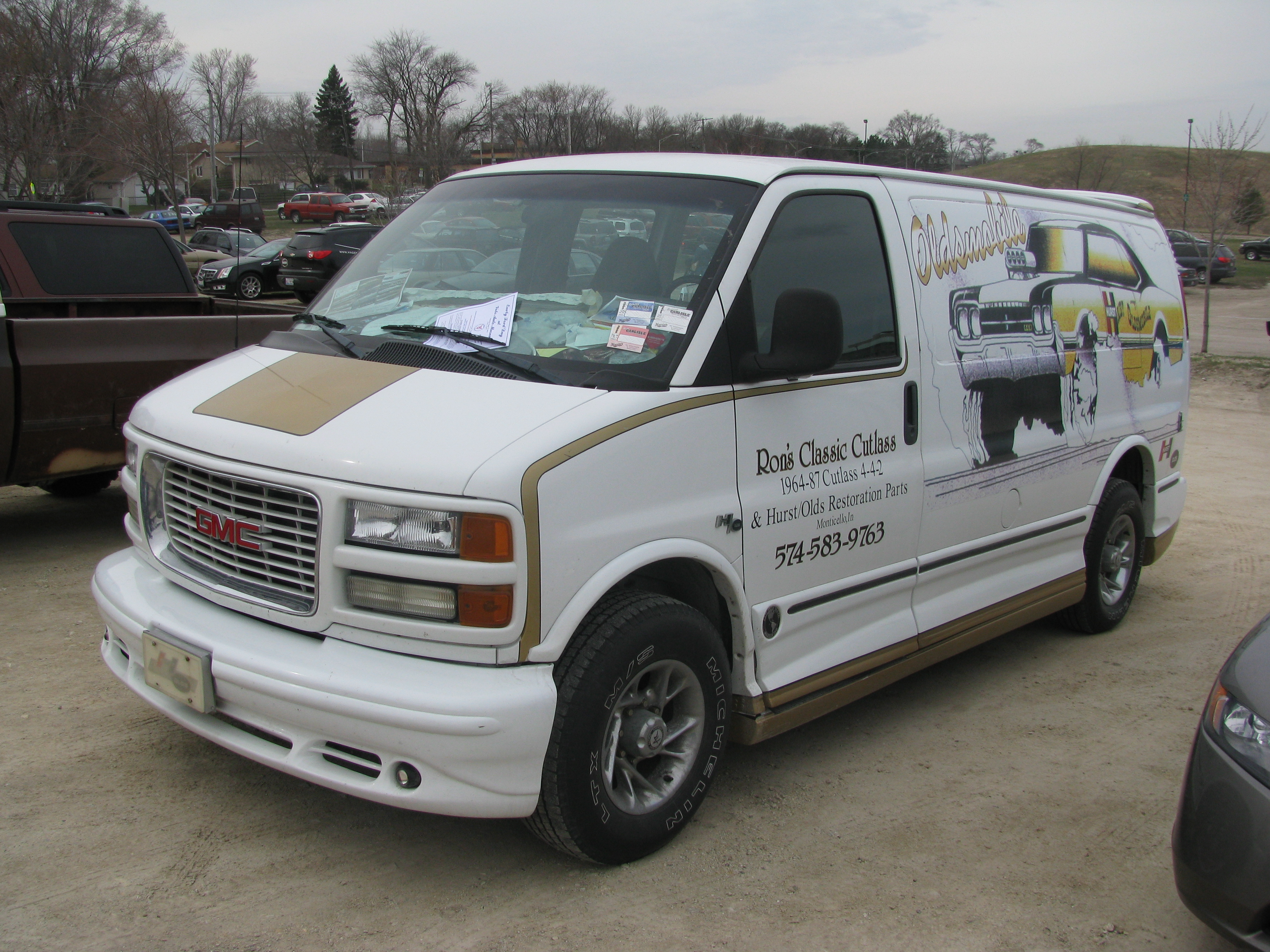 View Photo Of GMC Savana With Hurst Olds Artwork