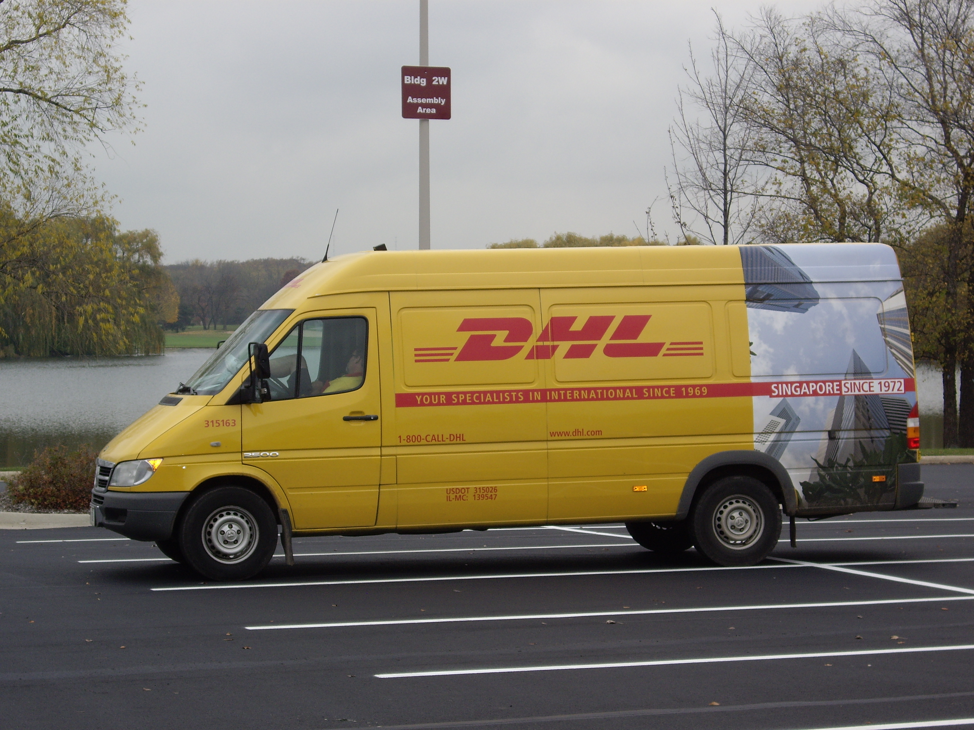 View photo of dhl dodge sprinter 3500 with sleeping driver